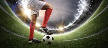 Football player in the stadium. The imaginary soccer stadium is modelled and rendered royalty free stock image