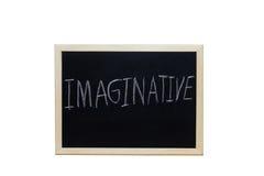IMAGINATIF écrit avec la craie blanche sur le tableau noir Photo libre de droits