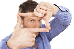 Imagination. A man looking and focusing through his hands royalty free stock image
