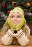 Imagination. Little girl is dreaming of Christmas gift Stock Images