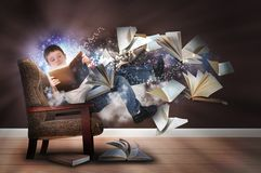 Imagination Boy Reading Books in Chair. A young boy is reading a book floating in space with glowing stars. There are books and paper flying up around him for an Royalty Free Stock Image