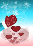 Snowflakes turn into hearts. Imagination collecting the cold white snowflakes warm mittens and turning them into hot hearts Stock Photography