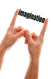 Imagination. Color vertical shot of two hands squeezing the word imagination Royalty Free Stock Photography