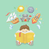 Imagination concept, boy reading a book,  rocket Stock Image