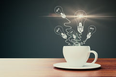 Imagination concept. Close up of coffee cup with abstract light bulb drawings. Imagination concept. 3D Rendering Stock Photography