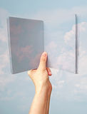 Imagination concept, hand hold book of blue sky and clouds Stock Photography