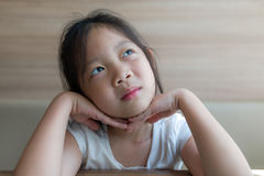 Imagination Concept Illustrated by Asian Child, Girl, Thinking a Royalty Free Stock Image