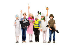 Imagination. A group of children dressed in costumes of different professions. Isolated over white Stock Images