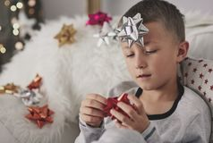 Cute little boy during Christmas. Imagination is my the best way on boredom Stock Image