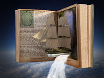 Imagination, Reading, Book, Story, Storybook. Storybook of imagination. A book with a tall sailing ship and waterfall provides a metaphor for reading and books stock photos