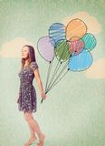 Imagination. Young woman is standing with drawn balloons Stock Photo