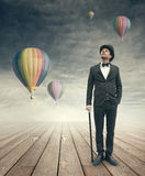 Imaginative vintage businessman with hot air ballons Royalty Free Stock Photography