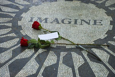 Imagine. Memorial photo with two roses and a white card Royalty Free Stock Image