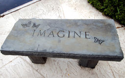 Imagine. Stone bench carved with the word Imagine on a commercial sidewalk at Sarasota FL Stock Images
