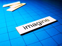 Imagine 2. The word imagine on a blue background Royalty Free Stock Images