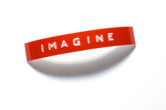 Imagine. The word Imagine done with old-fashioned punch-style lettering Stock Photos