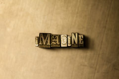IMAGINE - close-up of grungy vintage typeset word on metal backdrop Stock Images