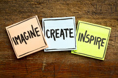 Imagine, create, inspire concept on sticky notes. Imagine, create, inspire concept - handwriting in black ink on sticky notes against rustic wood Royalty Free Stock Photography