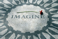 Imagine 01. A flower above the mosaic word 'Imagine' on the John Lennon memorial at Strawberry Fields, Central Park, New York Royalty Free Stock Images