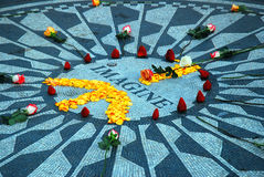 Imagine. Flower petals are done in a peace symbol at Imagine, a mosaic created in tribute to John Lennon in Central Park, New York stock photos