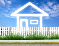 Imagine house. Icon with white fence and blue sky Stock Images