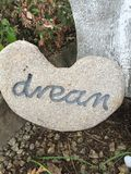 Dream. Inspirational thoughts, positive quotes, creative, rock, pebble, unique, personalized, dream garden-display, heart, ornament natural Royalty Free Stock Photos