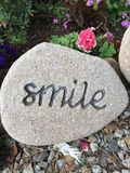 Smile. Inspirational thoughts, positive quotes, creative, rock, pebble, unique, personalized,natural rock Royalty Free Stock Images