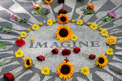 Imagine mosaic of John Lennon in Central Park. Imagine mosaic, full of flowers, at Strawberry Field in Central Park, New York, very hippie, flowers making the Stock Image