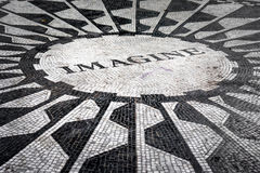 The Imagine mosaic at Strawberry Fields in Central Park, NY. The Imagine mosaic dedicated to John Lennon at Strawberry Fields in Central Park, New York City Royalty Free Stock Photo