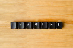 Imagine word. With keyboard buttons Stock Image