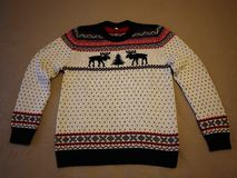 Men`s sweater with deer. Warm and beautiful sweater with drawings of deer. Details and close-up royalty free stock photo