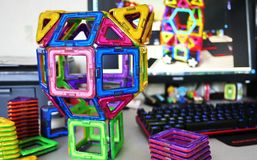 Bright geometric shapes on a magnetic base. Of these figures, the designer can assemble the various . Perfect for the develo royalty free stock photography