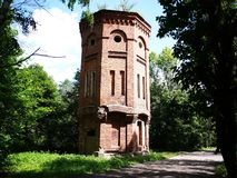 Old water tower. Beautiful tower in refined style. Details and close-up. royalty free stock photo