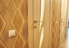The interior of a room installed with a new interior. door.The installed door harmoniously complements the interior of the room, b royalty free stock photography