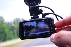A device for monitoring the situation on the road. Installed in the car. Details and close-up stock image