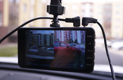 A device for monitoring the situation on the road. Installed in the car. Details and close-up royalty free stock photos