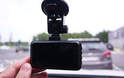 A device for monitoring the situation on the road. Installed in the car. Details and close-up stock photography