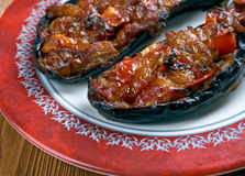 Imam bayildi. Dishes found in Turkish cuisine.whole braised eggplant stuffed with onion, garlic and tomatoes Stock Photos
