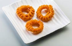 Imarti oder jalebi - ein indischer Bonbon Stockfotos