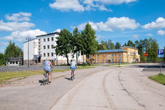 Imatra. Finland. People on Kanavakatu Street. IMATRA, FINLAND - JULY 2, 2016: People on the bicycles ride on Kanavakatu Street. On the background is The Finnish stock images