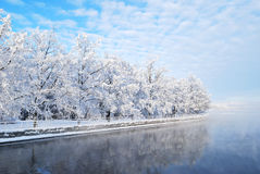 Imatra reservoir. Finland. Fog over the water of Imatra reservoir and  snowy park Kruunupuisto Royalty Free Stock Photography