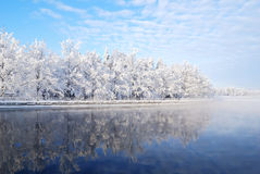 Imatra reservoir. Finland. Fog over the water of Imatra reservoir and  snowy park Kruunupuisto Stock Photography