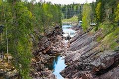 Imatra, Suomi or Finland. Vuoksa river and rocky canyon view in Imatra, Finland Stock Photos