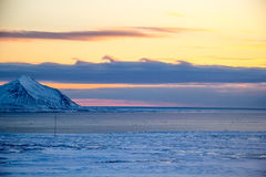 Imazing clouds over arctic fjord royalty free stock photography