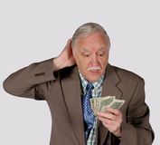 Imbécile et son argent Photo libre de droits