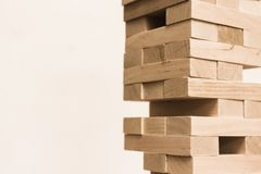 Imbalance in the board game jenga. Board game jenga. Wooden blocks. A logic game for two and a company. Entertainment for adults and children. Useful leisure royalty free stock photography