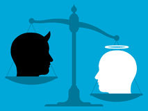 Imbalanced scale with an angel and the devil Royalty Free Stock Photo