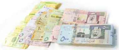 Imballa la valuta di carta sopra a vicenda Immagine Stock