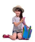 Imballaggio della bambina il suo personale da andare vacation Fotografia Stock