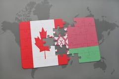 imbarazzi con la bandiera nazionale del Canada e della Bielorussia su un fondo della mappa di mondo Fotografia Stock